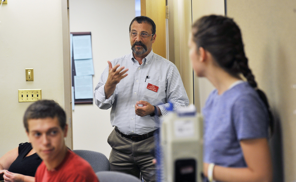 Joe Balzano, a registered nurse, talks with students during training for certified nursing assistants at the Barron Center in Portland last month. Starting pay for CNAs is $12.92 an hour, according to city officials.