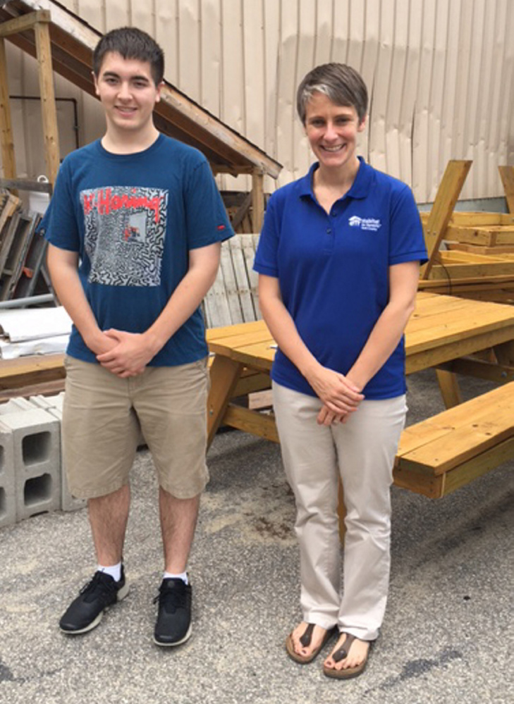 Cole Cerabona of West Kennebunk earned Eagle Scout status for successfully building picnic tables, pictured, for Habitat for Humanity York County. Habitat executive director Amy Nucci is at right.