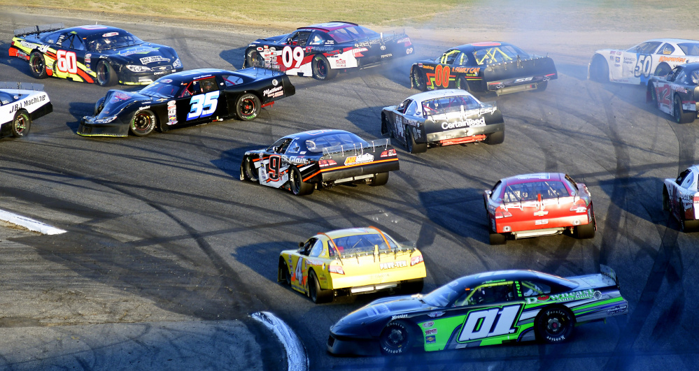 Cars get spun out after a multi-car crash during the Oxford 250 on Sunday at Oxford Plains Speedway.