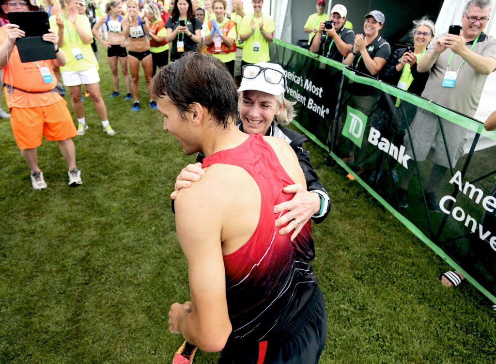 Ben True is greeted by Joan Benoit Samuelson, the race founder, after becoming the first American to win the Beach to Beacon last year. True will race again Saturday.
