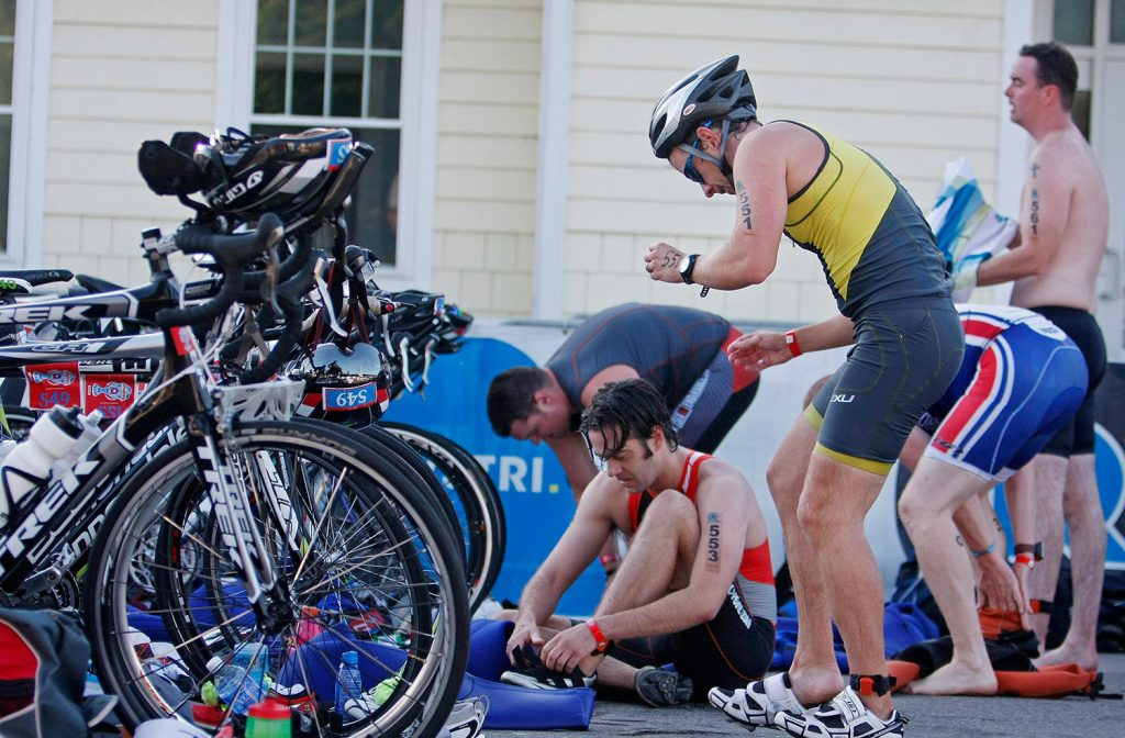 Athletes transition from the swim to the bike portion of the Rev3Triathlon in 2014. This year's race, now called the Ironman 70.3 Maine, is scheduled Sunday and expected to draw more than 2,000 triathletes.