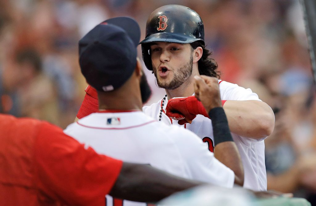 Boston Red Sox's Andrew Benintendi, right, celebrates with Chris Young after his solo home run off Cleveland Indians starting pitcher Trevor Bauer during the third inning Monday. Benintendi's stats since the All-Star break are comparable to Yankees' phenom Aaron Judge.