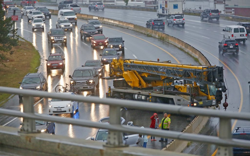 Traffic was slowed in both directions Friday afternoon after a crane crashed in the southbound lane just south of Tukey's Bridge on Interstate 295 in Portland on Friday afternoon.