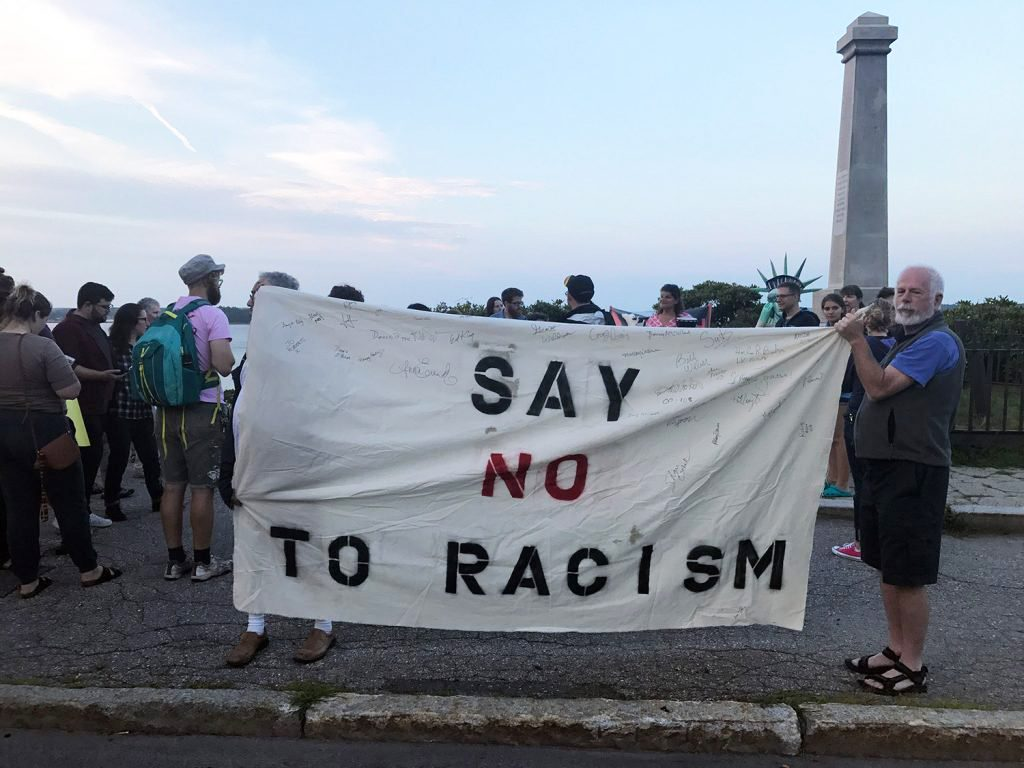 People turn out at Portland's Eastern Promenade on Saturday evening to stand in solidarity with the victims of the violence in Charlottesville, Va. Earlier Saturday, a car plowed into a crowd after white supremacists and counterprotesters clashed.