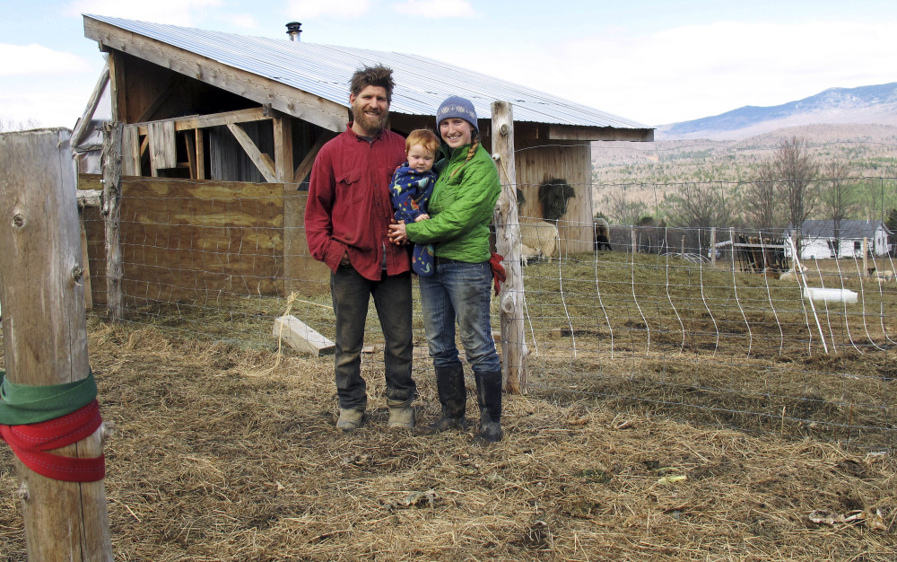 A young family is shown at their farm in Worcester, Vt., in this 2014 photo. A $90,000 National Endowment for the Humanities grant will highlight Vermont farmers who don't fit the stereotype – those who are female, racially diverse or don't necessarily raise dairy cows.