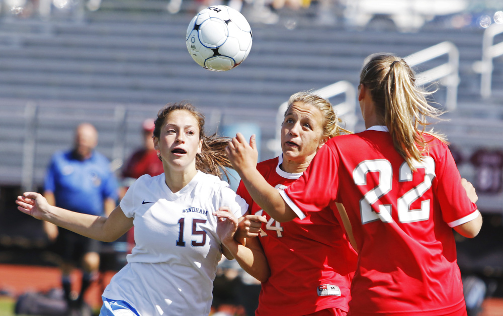 Windham's Hannah Kaplan, left, battles with Kaya Beckman, center, and Lauren Elsemore of South Portland in the second half of their girls' soccer season opener Saturday in Windham. Kaplan scored her team's second goal in a 2-0 win.
