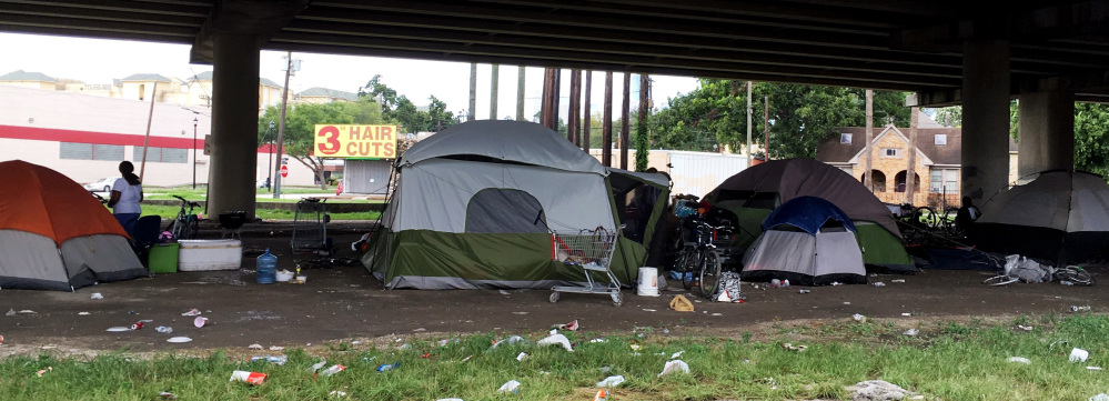 For dozens of homeless people living beneath the Interstate 59 overpass in Houston, Hurricane Harvey meant rain and muddy ground, matters that didn't have them seeking refuge in the many shelters that would have welcomed them.