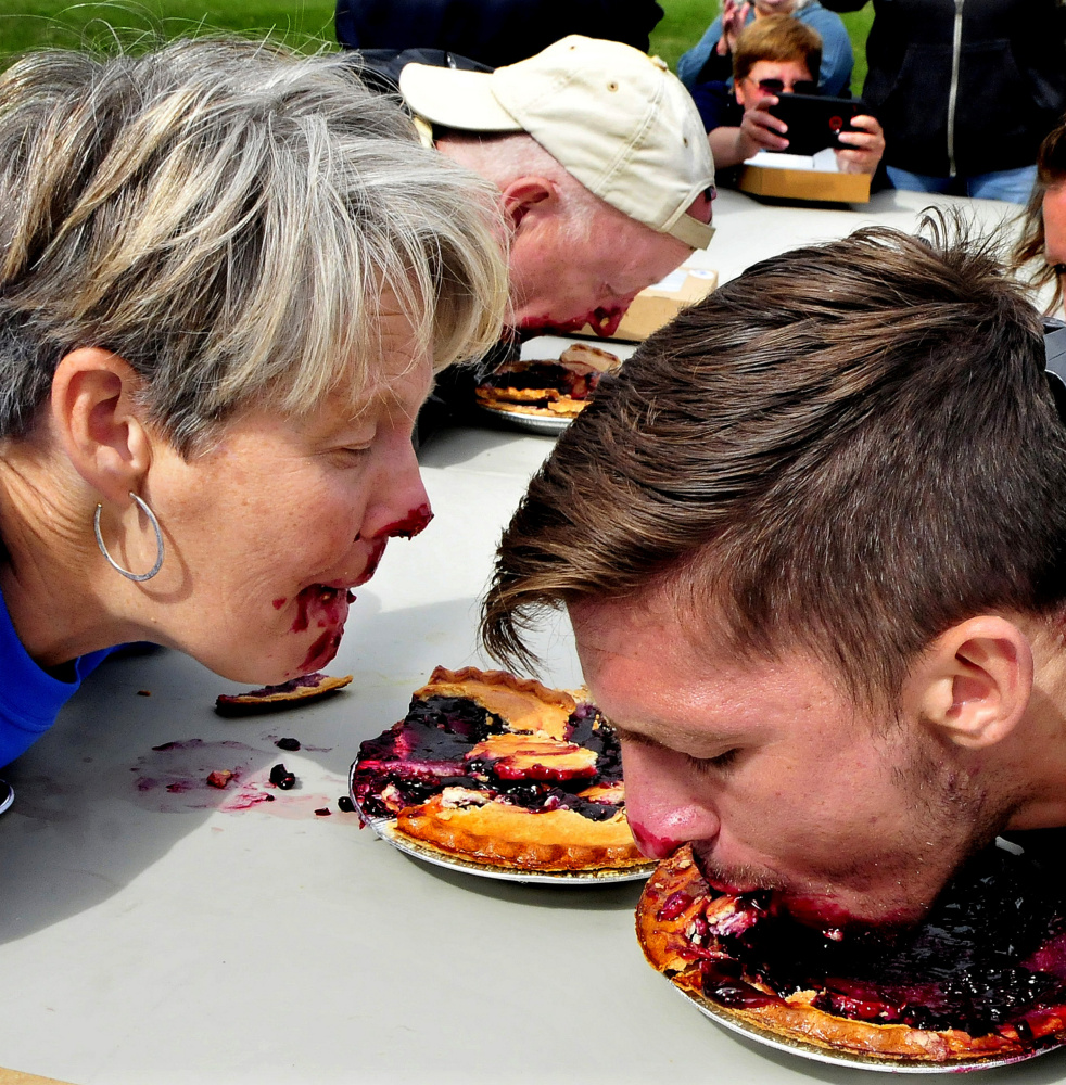 From left, Democratic candidates for governor Betsy Sweet of Hallowell and Patrick Eisenhart of Augusta and U.S. Senate candidate Zak Ringelstein compete in a pie eating contest Sunday.