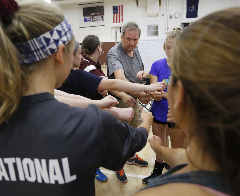 Greely High volleyball coach Kelvin Hasch doesn't believe the new three-class volleyball system will help the sport, and other successful coaches back him up.