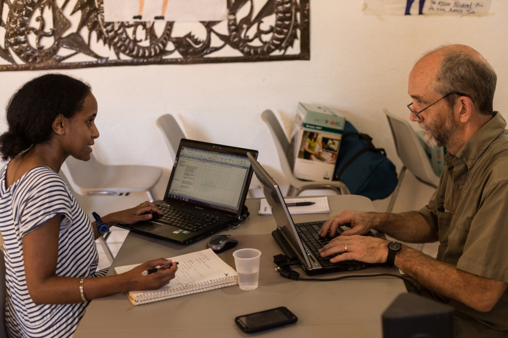 Konbit Sante's Country Director Tezita Negussie, left, works with Executive Director Nate Nickerson in Haiti. Negussie left Portland in January. Nickerson is headed there Wednesday.