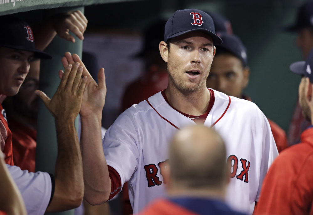 Doug Fister is congratulated by Red Sox teammates after being pulled during the eighth inning of a win against Cleveland on July 31 in Boston. After a bit of a rocky beginning, Fister now has a 3.61 ERA as a starter this season.