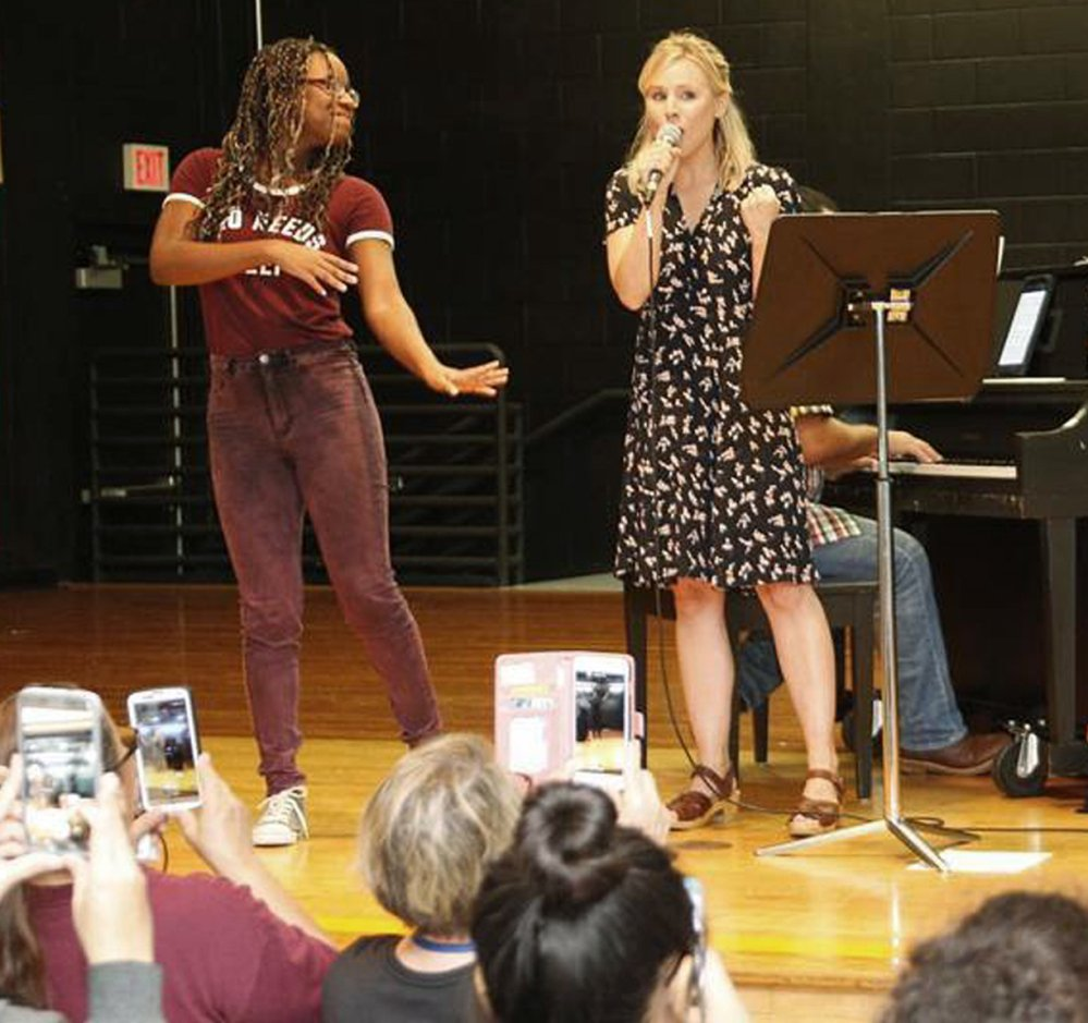 Kristen Bell sings to evacuees taking refuge from Hurricane Irma at a shelter in Orlando, Fla., on Sunday.