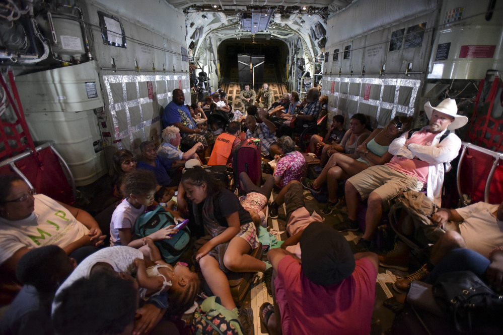 U.S. Air force personnel evacuate U.S. citizens from St. Martin aboard an aircraft after the passage of Hurricane Irma on Tuesday.