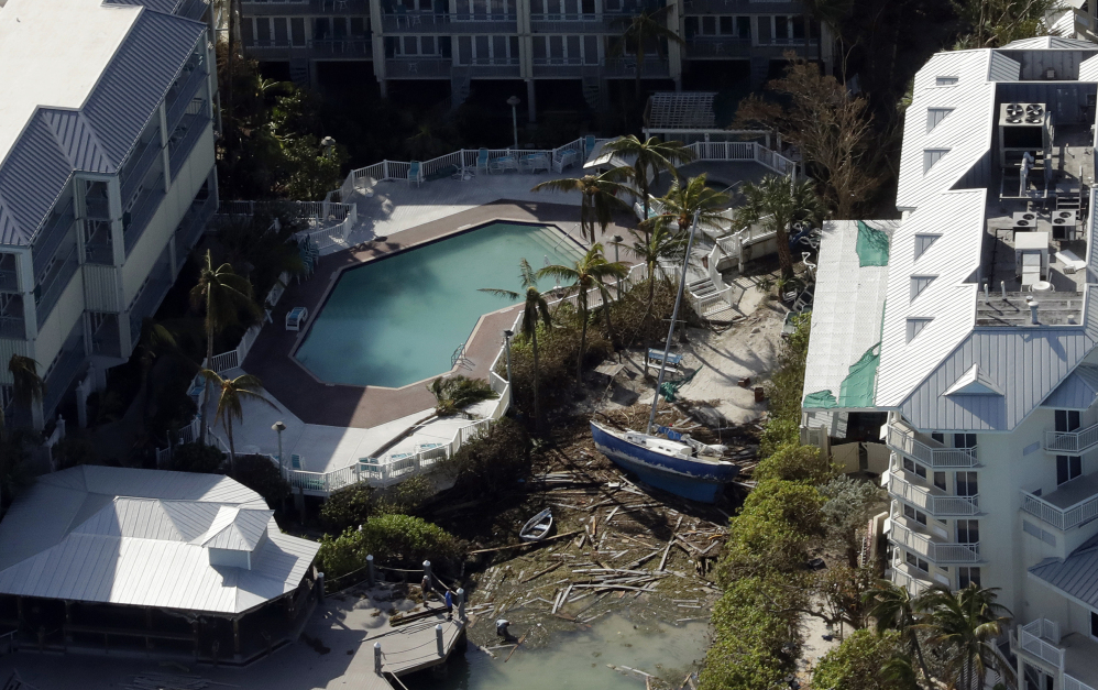 A sailboat rests between buildings in the aftermath of Hurricane Irma on Tuesday in Key West, Fla. Many parts of the state remain off-limits to visitors, with extensive damage or power outages that could take weeks to resolve.