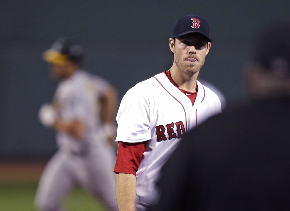 Red Sox starter Doug Fister waits for a fresh baseball as Oakland's Matt Olson rounds the bases after hitting a two-run home run in the first inning at Fenway Park Wednesday night.