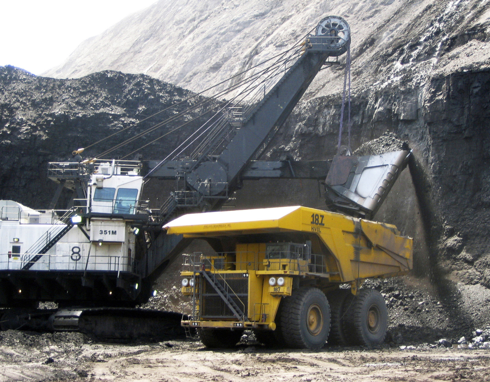 A shovel dumps coal into a truck at the Black Thunder mine in Wright, Wyo. A federal appeals court has sided with environmentalists trying to block mining at the two biggest coal mines in the U.S.