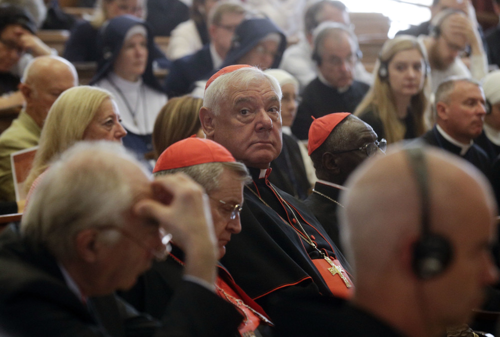 Cardinal Gerhard Ludwig Mueller, center, shown at a recent conference on the Latin Mass at the Pontifical University of St. Thomas Aquinas in Rome, was fired as Vatican doctrine chief.