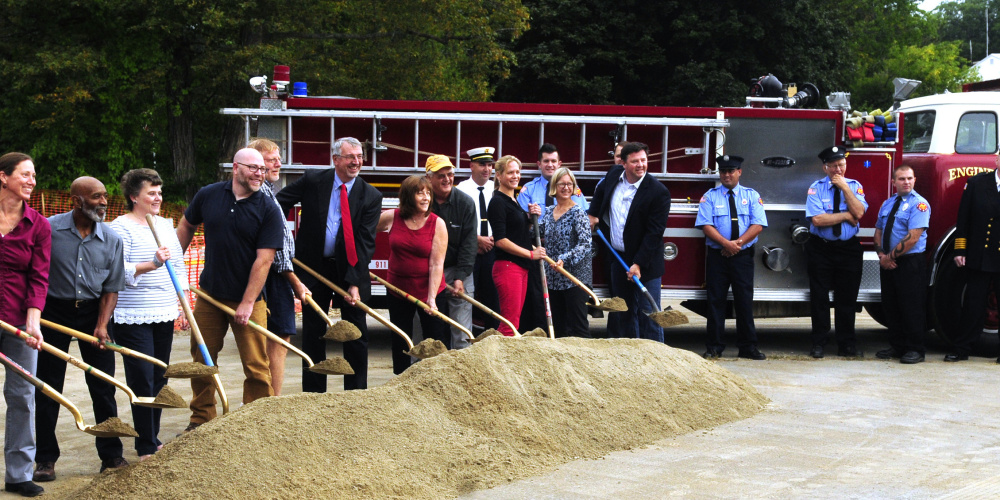 Hallowell city officials and firefighters take part in a groundbreaking ceremony Friday for the planned new Hallowell fire station Friday at Stevens Commons.