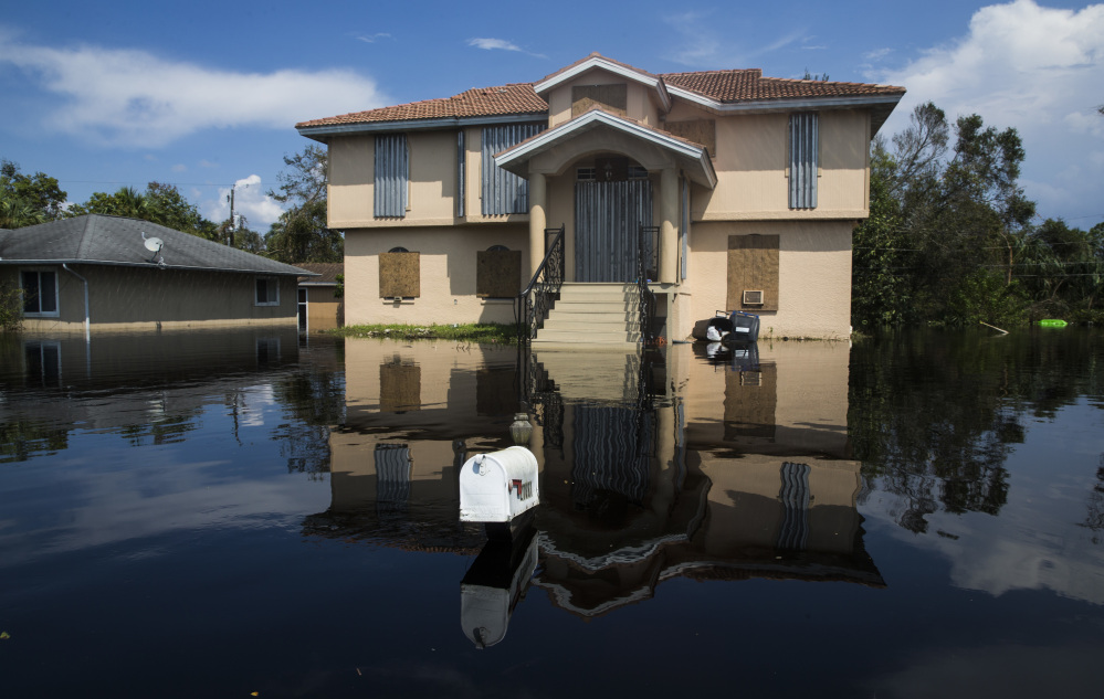 Flood waters touch the bottom of a mailbox in Bonita Springs on Florida's Gulf Coast as the effects of Hurricane Irma continue to render parts of the state unlivable