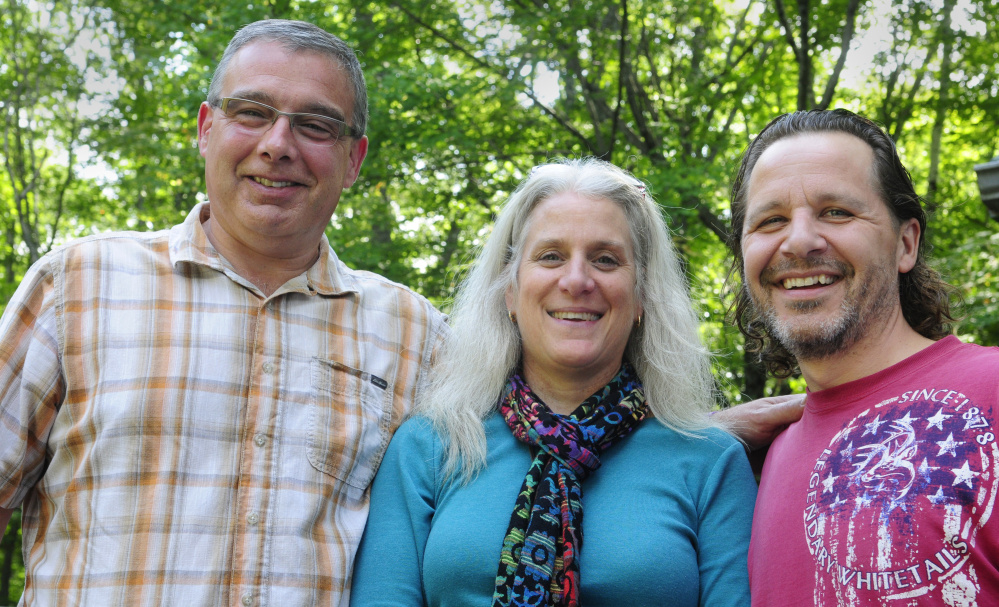 From left, Darren Ripley, executive director of the Maine Alliance for Addiction Recovery, meets with Karen Hardy and Stephen Hardy on Thursday in Belgrade. Stephen Hardy cycled 162 miles, from Bucksport to Machias and back to Ellsworth, to raise awareness and money for addiction services.