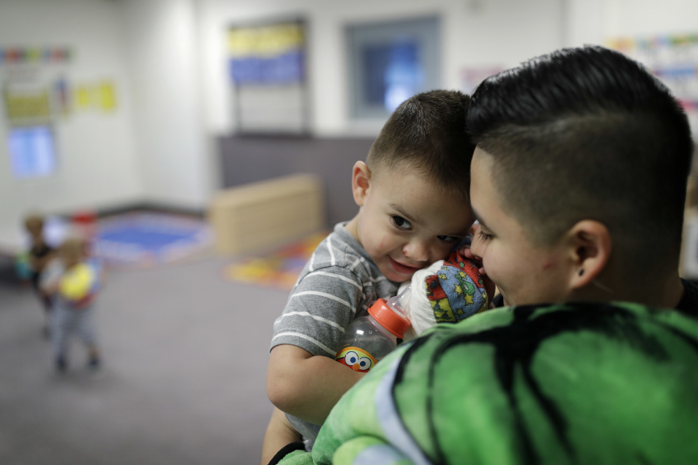 Precyla Escobar holds her 2-year-old son, Zeke, at the McCarran International Child Development Center in Las Vegas. Those who work outside of the 9-to-5 shift are lost in the national conversation over access to child care and early education.