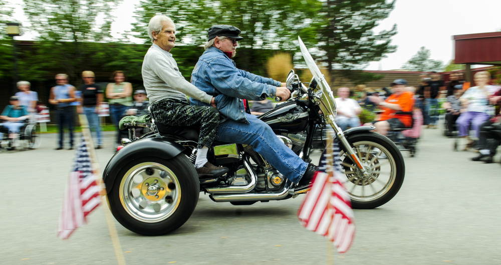 Alfred King gets a ride on the back of Alfred Tuttle's 2003 Harley-Davidson Dyna Super Glide trike Saturday at the Maine Veterans Home in Augusta. Tuttle, of Madison, gave several residents rides around the parking lots before a fundraiser ride took off for Lewiston.