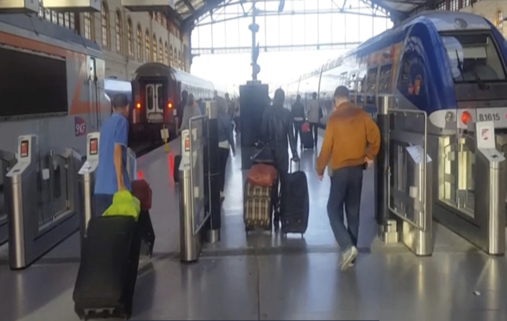 This image taken from video shows passengers inside Marseille-Saint-Charles railway station in Marseille, France, on Sunday.