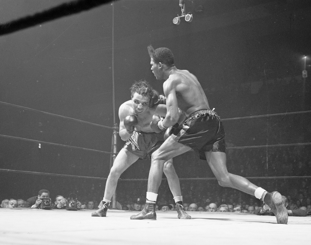 Jake LaMotta, left, and Ray Robinson fight at Madison Square Garden in New York. in 1945.