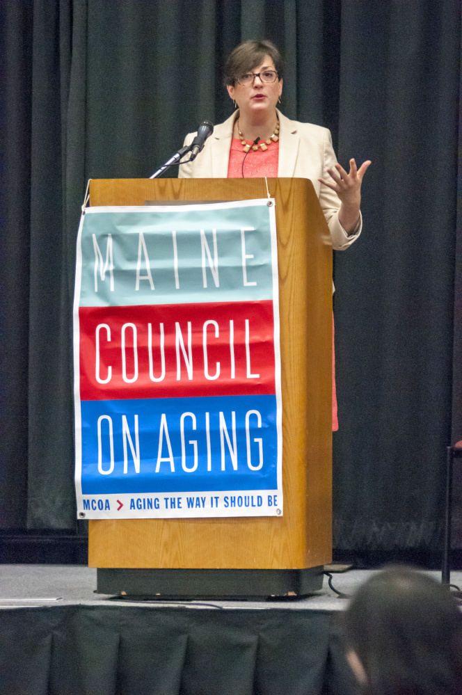 Julie Sweetland, vice president for strategy & innovation at the FrameWorks Institute, gives the keynote address during Maine Council on Aging event on Wednesday at the Augusta Civic Center.