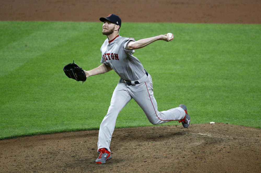Boston Red Sox starting pitcher Chris Sale throws to the Baltimore Orioles in the eighth inning of a baseball game in Baltimore, Wednesday, Sept. 20, 2017. Sale threw his 13th strikeout in the eighth to become the first AL pitcher in 18 years to reach the 300 mark. Boston won 9-0.
