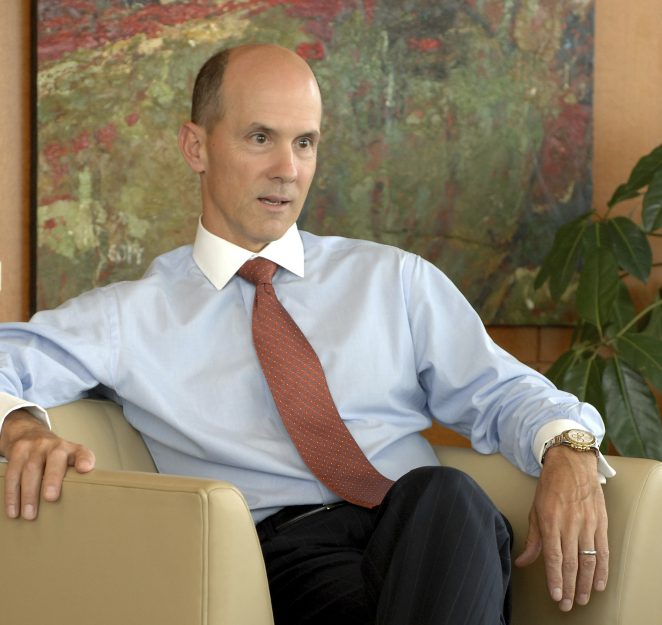 Equifax CEO Richard Smith poses for a photo at the Equifax headquarters in Atlanta. State and federal authorities are proposing tougher regulations against Equifax and the entire credit monitoring industry after the company announced that personal information like Social Security numbers of about 143 million Americans was exposed.