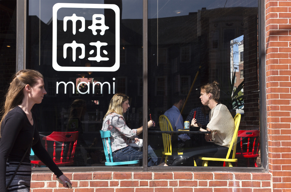 Marisa Polk and Jeanette Baum, right, take a lunch break from their jobs at CIEE to eat at nearby Mami on Fore Street in Portland.
