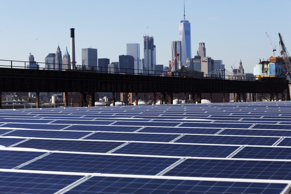 This February photo shows solar panels at the Brooklyn Navy Yard in New York. Solar panels imported from China and other countries have led to a boom in the U.S. solar industry, where rooftop and other installations have surged tenfold since 2011.