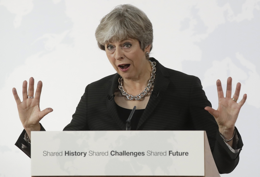 Associated Press/Alessandra Tarantino British Prime Minister Theresa May delivers her speech in Florence, Italy, on Friday. May will try to revive foundering Brexit talks and unify her fractious government by proposing a two-year transition after Britain's departure from the European Union in 2019, during which the U.K. would continue to pay into the bloc's funds.