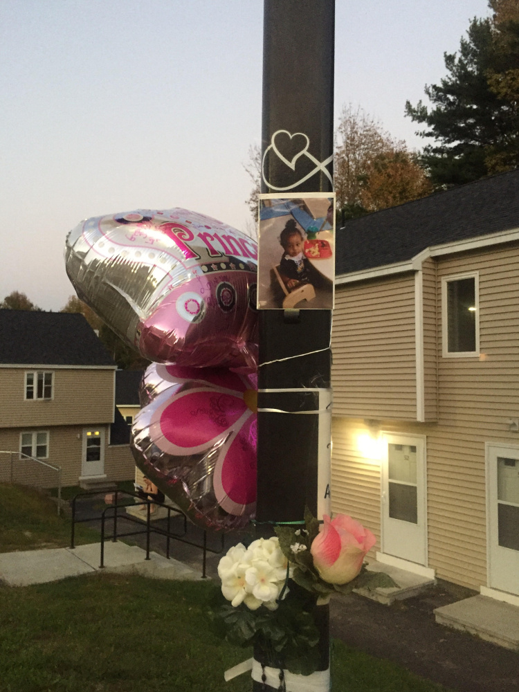 Neighbors, family members and members of the community built a memorial to 17-month-old Tiannah Sevey just outside her home in Lewiston on Sunday.
