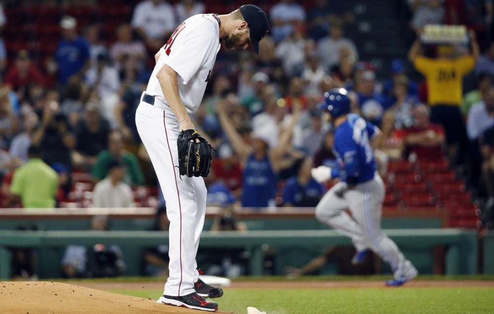 Boston's Chris Sale did not have a good night against the Blue Jays on Tuesday at Fenway Park. He allowed four home runs, including a first-inning homer to Josh Donaldson. Sale was lifted after five innings and dropped to 17-8.