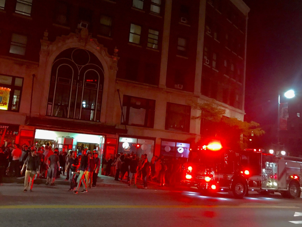 Portland firefighters respond to a smoke alarm set off Tuesday night at the State Theatre during a performance by the Pixies.