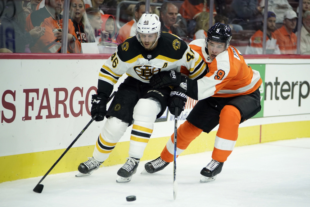 David Krejci, left, of the Bruins battles with Philadelphia's Ivan Provorov during the first period of Thursday's preseason game in Philadelphia. Boston goalie Tuukka Rask allowed four goals on 18 shots and the Bruins lost, 5-1.