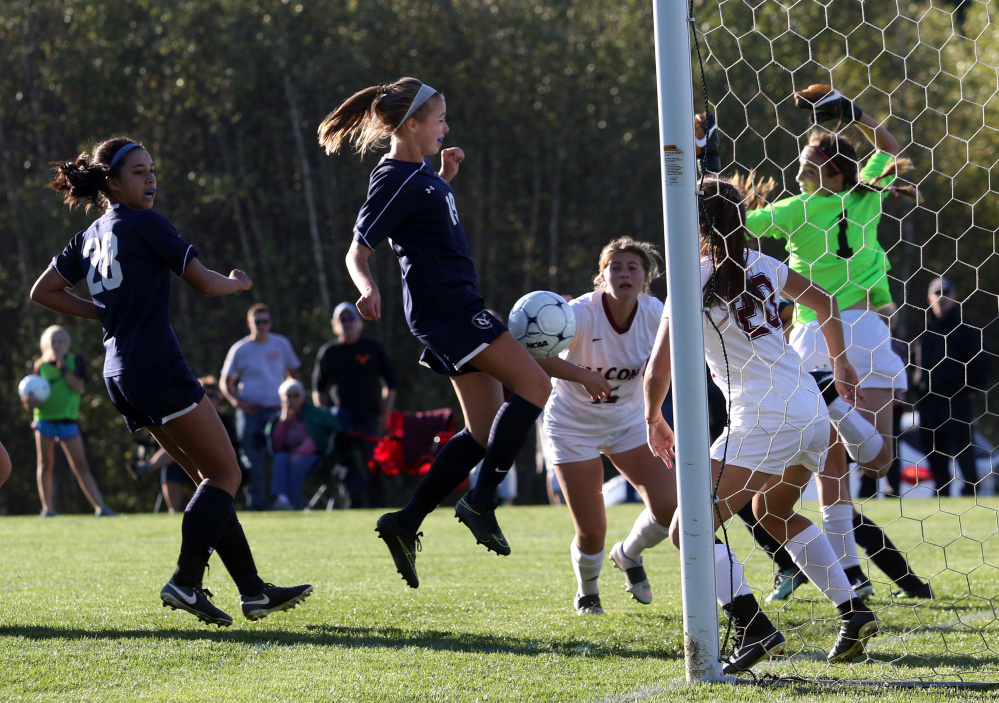 Ashlyn Feeley of Yarmouth uses her knee to get the ball into the goal Friday during a 6-0 victory against Freeport in a Western Maine Conference girls' soccer game at Freeport High.