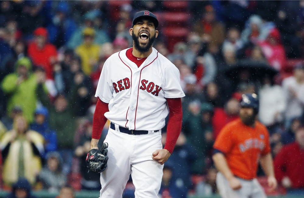 David Price of the Red Sox reacts after striking out Houston's George Springer to retire the side with the bases loaded in the seventh inning Saturday in Boston. Boston beat Houston, 6-3, to clinch their second straight American League East title.