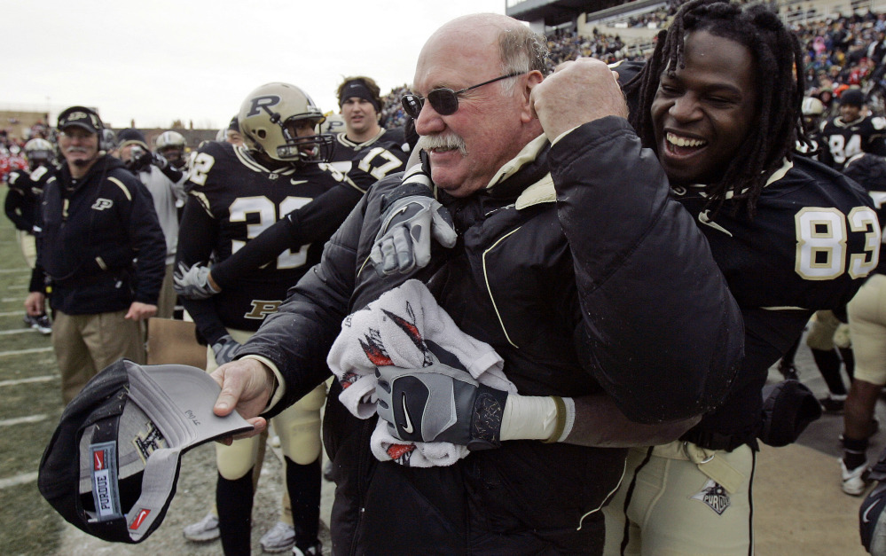 Postgame celebrations became common under the late Purdue football coach Joe Tiller, who compiled an 87-62 record with the Boilermakers between 1997 and 2008. Tiller died Saturday at 74 at his home in Wyoming.