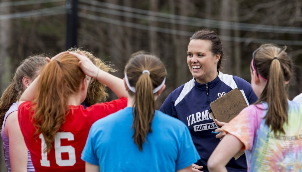 Then-Yarmouth softball coach Amy Ashley talks to team members in this April 2016 photo. The team won the state Class B state title the year before.