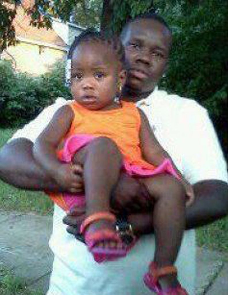 This undated family photo shows Anthony Lamar Smith holding his daughter Autumn Smith.