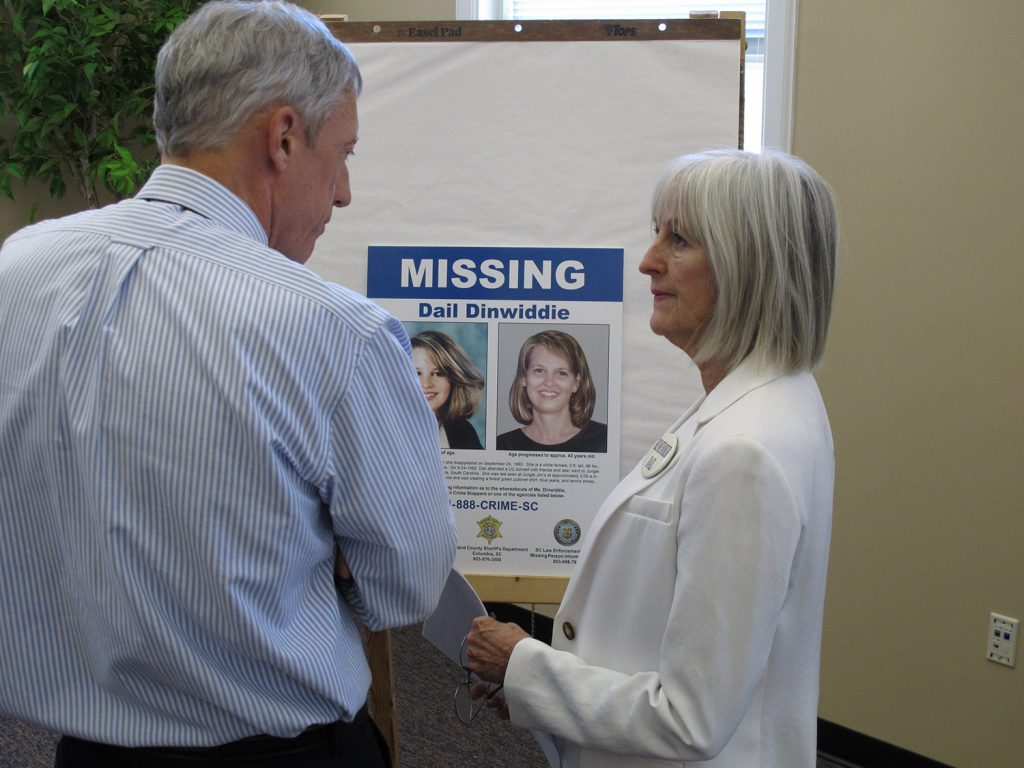 Jean Dinwiddie talks to WIS-TV reporter Jack Kuenzie about a new photo of what her daughter Dale Dinwiddie might look on Aug. 13, 2012, in Columbia, S.C. Dail Dinwiddie was last seen at a Columbia bar after watching a U2 concert in September 1993.