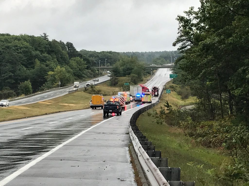 Emergency vehicles tend to a jackknifed semi truck on Route 1 just north of Brunswick.  Staff photo by Rachel Leonard
