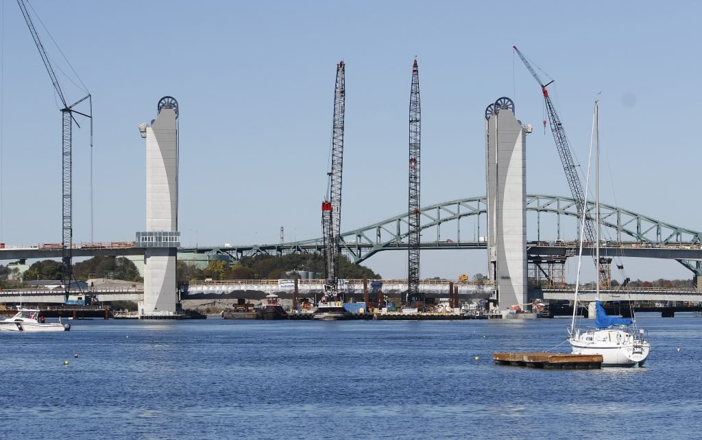 A 4 million-pound structural steel span the length of a football field was floated over the Piscataqua River on two barges Tuesday and maneuvered into place at the center of the new bridge that connects Kittery with Portsmouth, N.H.
