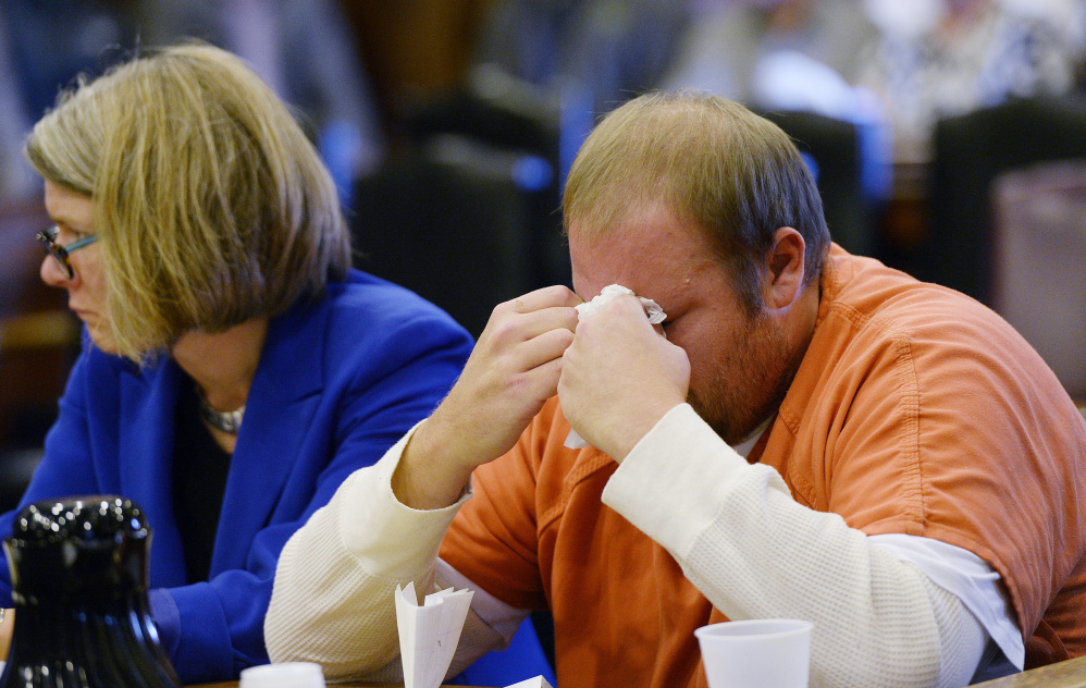 Joshua McNally wipes away tears Monday after speaking at the Cumberland County Courthouse, where he was sentenced to six years for the motor vehicle death of Adam Perron.