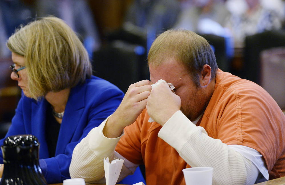 Joshua McNally wipes away tears after speaking at the Cumberland County Courthouse where he was sentenced in connection to the motor vehicle death of Lake Region Middle School science teacher Adam Perron.