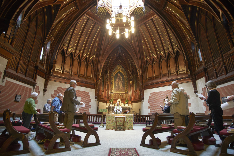 The Rev. Ben Shambaugh starts a service at St. Luke's Cathedral in Portland at noon on Tuesday after opening the church for a national time of prayer for the victims in the Las Vegas shooting.