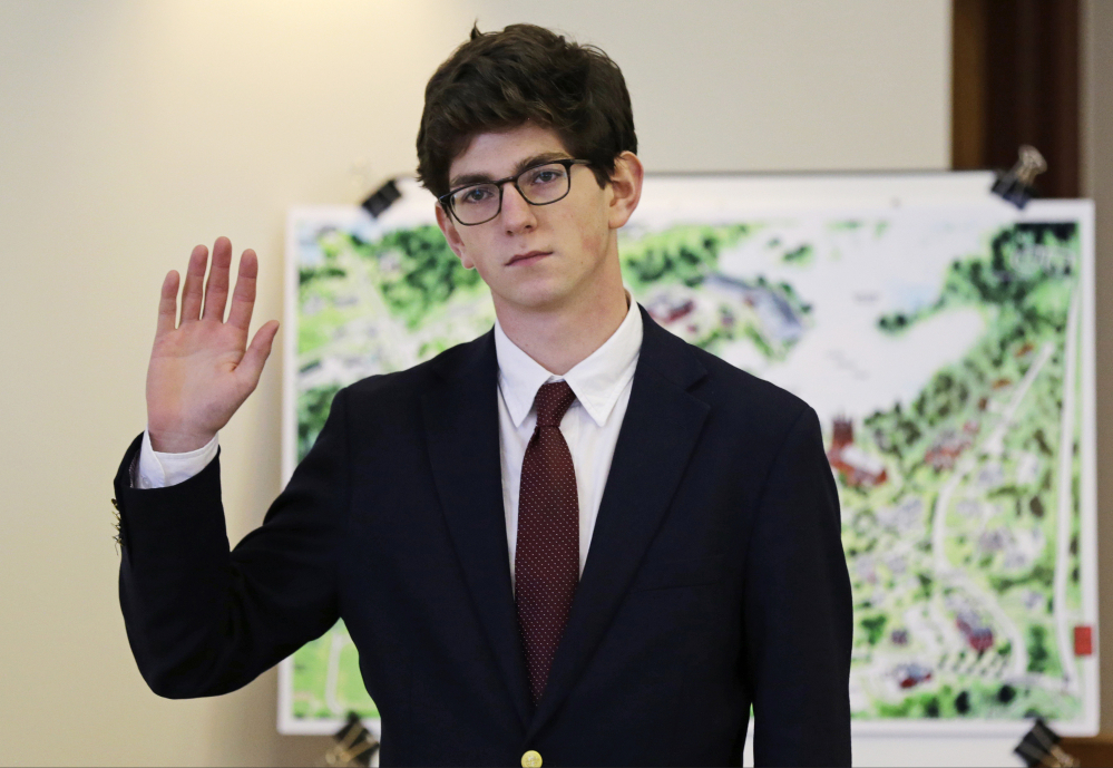 St. Paul's School graduate Owen Labrie raises his hand to be sworn-in prior to testifying in his trial at Merrimack Superior Court in Concord, N.H. in 2015.